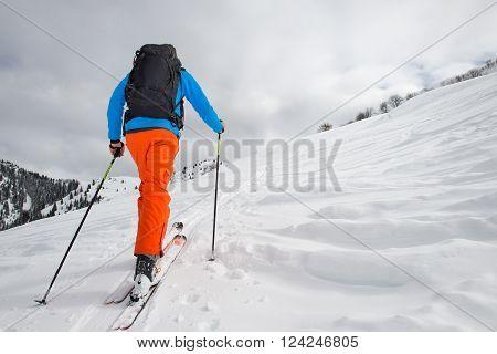 Man With Ski Mountaineering Climb Towards The Summit