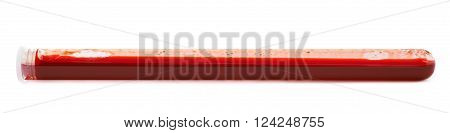 Glass test-tube filled with blood isolated over the white background