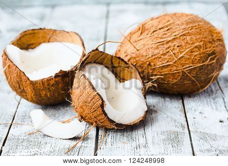 Fresh Coconuts In The Shell On A Blue Wooden Background
