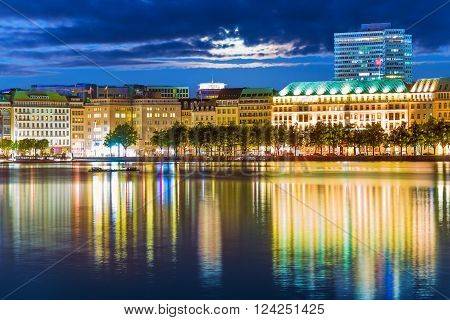 Scenic summer night view of the Old Town architecture and pier of Alster lake and river in Hamburg, Germany