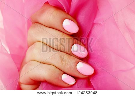 Female Hand With Manicure On A Pink Background