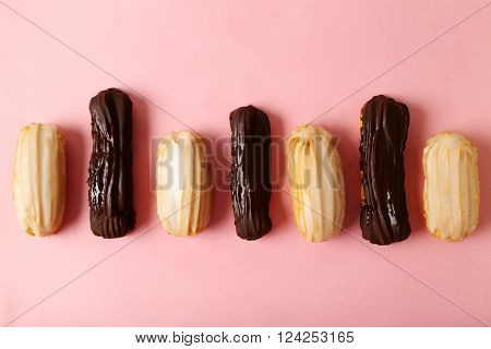 Sweet And Tasty Eclairs On A Pink Background