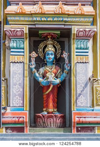 Trichy, India - October 15, 2013: Statue of Vishnu-Durga in her own shrine. Blue skin and carrying the conch and the discus, and pours milk.  Powerful image of Vaishnavism. She could be taken for Lakshmi, too.