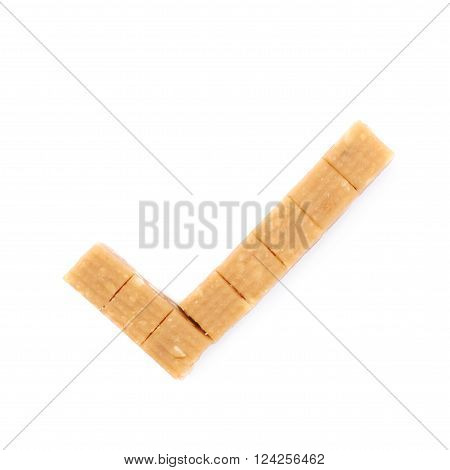 Tick shaped toffee candy with nuts, composition isolated over the white background