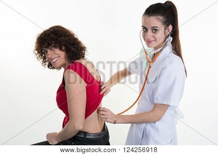 Doctor Woman Auscultating Patient Spine By Stethoscope