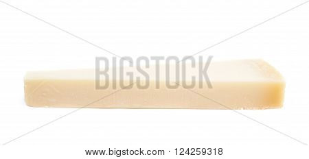 Piece of a parmesan cheese isolated over the white background