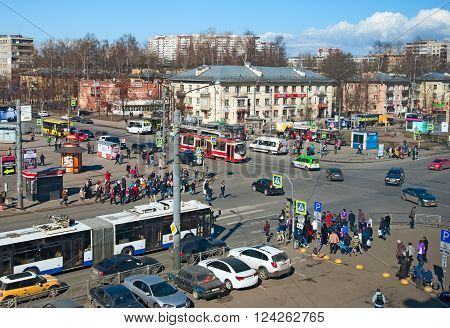 SAINT - PETERSBURG, RUSSIA - APRIL 3, 2016: Top view of the Grazhdansky and Nauki Avenue with city transport and crowd of people on a pedestrian crossing.near Akademicheskaya Metro