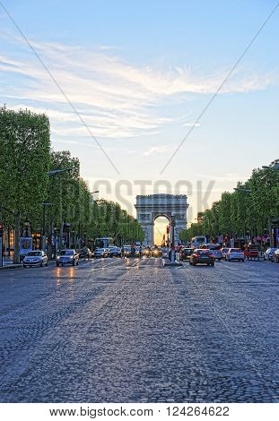 PARIS FRANCE - MAY 3 2012: Triumphal Arch of the Star in Paris in France in the evening. The Arc de Triomphe de Etoile is one of the most known monuments of Paris