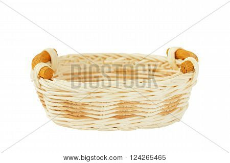 Wicker basket isolated on white background. Kitchen accessory. Wicker basket for serving.
