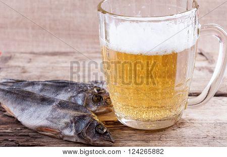 dried fish and beer mug still life