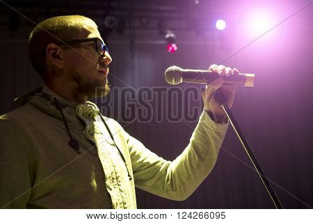 Singer Holding A Microphone And Singing