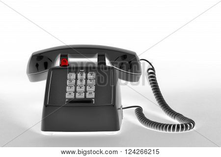 Old style telephone in reversed black and white.