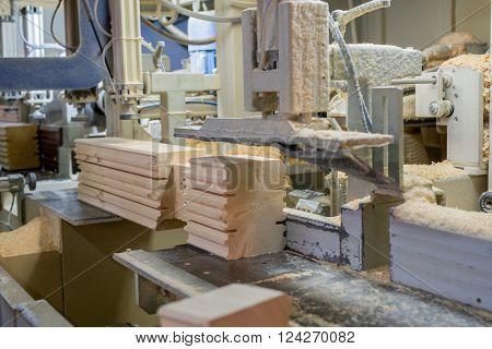At sawmill. Image of profiled bar during processing, close-up
