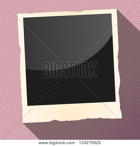 Black instant photo with torn frame and long shadow is on squared, striped surface.