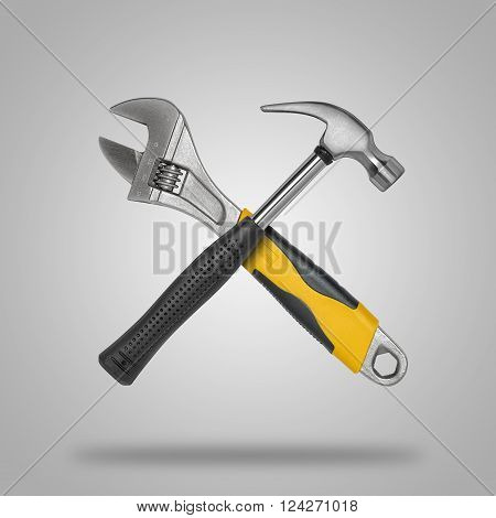 Crossed hammer and wrench. Tools for carpentry work.