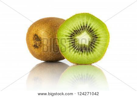 Whole kiwi fruit and a half placed next to it isolated on white background. All in focus using focus stacking technique