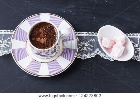Turkish coffee and Turkish delight on a black background