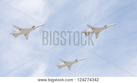 Moscow - May 9 2015: Three Tu-22M for the codification of NATO: backfire supersonic bomber-missile in flight to the Victory Parade in Moscow on May 9 2015 Moscow Russia