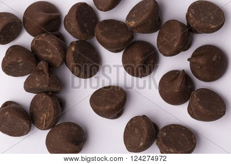 A random collection of milk chocolate chips.