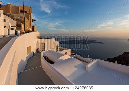 Panoramic view of Santorini island and Sunset over town of Imerovigli, Thira, Cyclades, Greece