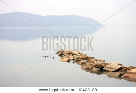 Scenic view of the Hudson River featuring a jetty on a very calm day.