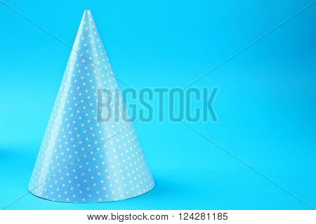 Dotted Birthday hat on blue background