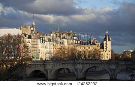 PARIS, FRANCE - MARCH 25:.View of Cite Island (Ile de la Cite) in the sunset and dramatic sky