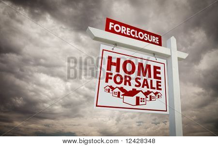 White and Red Foreclosure Home For Sale Real Estate Sign Over Ominous Cloudy Sky.