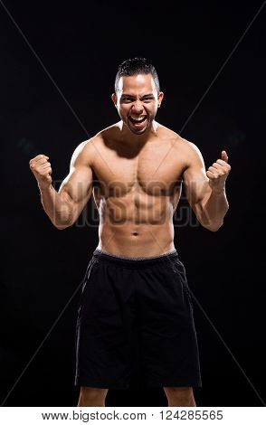Shirtless Furious man screaming on Black Background