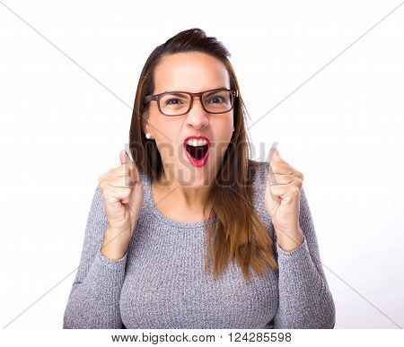 winning success woman happy celebrating. She is wearing eyesglasses and gray sweater on white backgrond winning success woman happy celebrating. She is wearing eyeglasses and gray sweater on white background