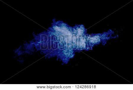 Cloud of powder on dark blue background