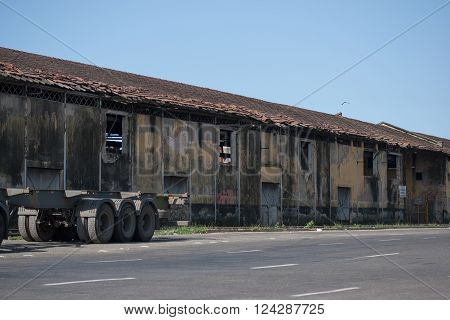 Truck wheels in front of old decaying warehouse with