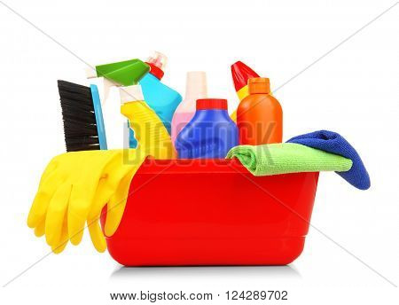 Cleaning set with tools and products in plastic tub, isolated on white