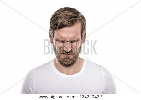 Stressful young man isolated on white background.