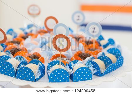 Blue paper packaging with candies and number one sign