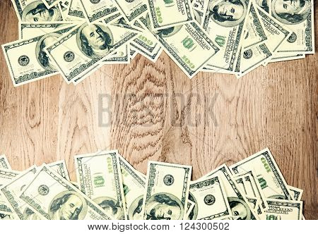 banknotes on wooden background.a place for lettering
