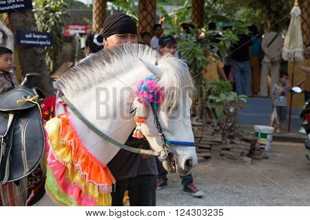 CHIANG MAI, THAILAND - APRIL 2: people and horse participate in traditional buddhist monk ordination ceremony at Roy Jun temple in Chiang Mai, Thailand on April 2, 2016.