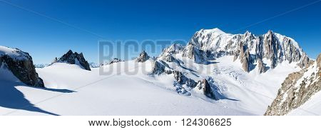 Mont Blanc, France: winter panorama on the east face from Geant Glacier. On the right the pinnacles of Mont Maudit. On the left the upper station of the Skyway cable-car from Courmayer, Italy.
