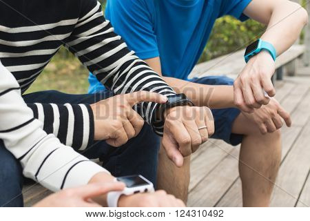 Group of people using smart watch