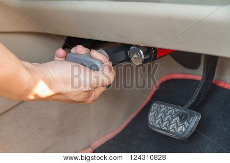 Pull for lock brake pedal of the car