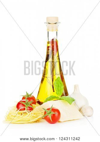 Pasta, tomatoes, basil, olive oil and parmesan cheese. Focus on tomato. Isolated on white background