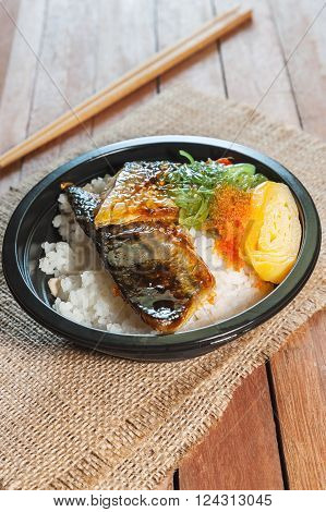 Japanese food style Saba fish grilled set with rice on wooden background in still life style
