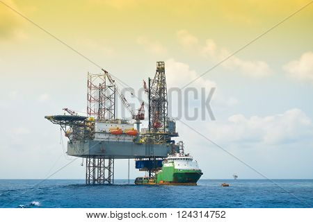 Oil and rig platform operation in north sea, Heavy industry in oil and gas business in offshore, rig operation.