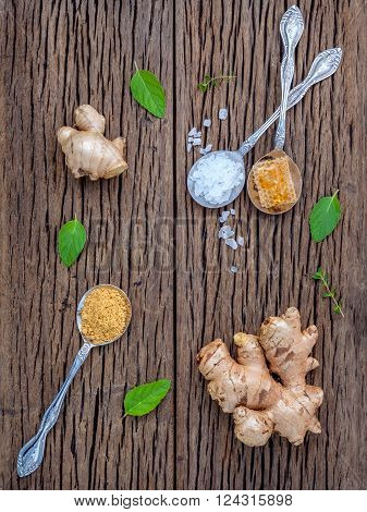 The Ingredients Of Ginger Tea With Ginger Roots , Ginger Powder , Honey And Peppermint On Rustic Woo
