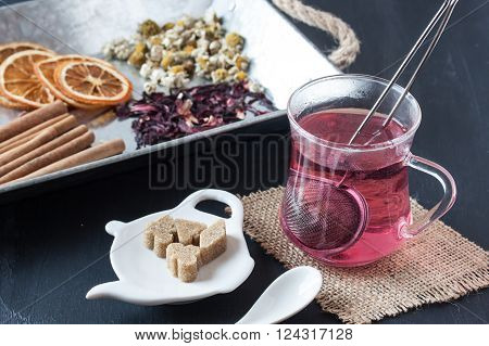 assorted herbal tea on a black background