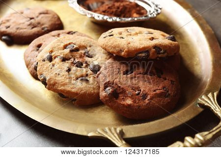 Chocolate chip cookies on a metal tray, closeup