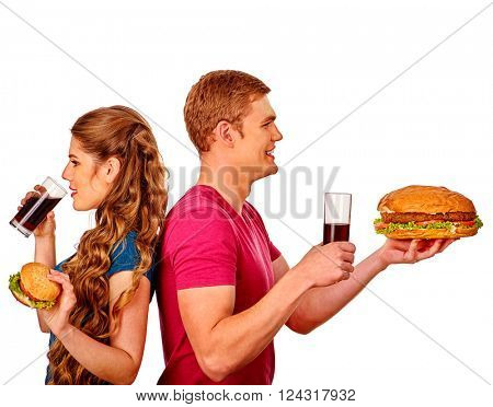 Young man and woman holding big hamburger and drink with gaz . Fastfood concept. Isolated.