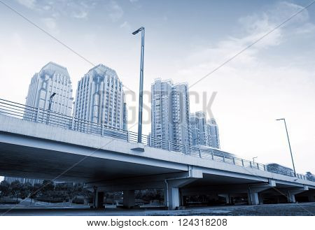 Urban overpass busy traffic, blue tone picture