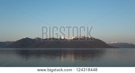 Mountains reflect in the waters outside Alaska's Glacier Bay