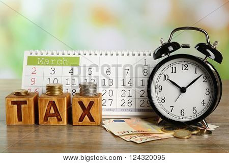 Tax time and alarm clock with euro and calendar